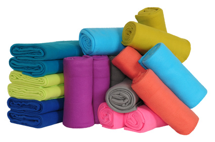 Photo of a pile of rolled up blankets