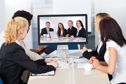 Photo of a team of people attending a virtual business conference