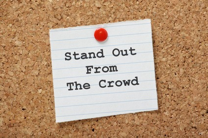 Note pinned to cork board - Stand Out From the Crowd
