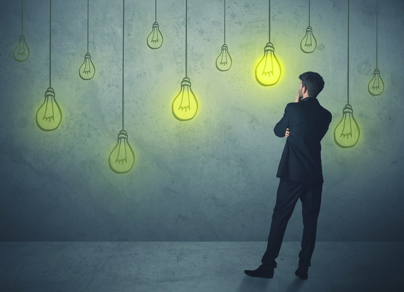 businessman with hanging lighting bulbs