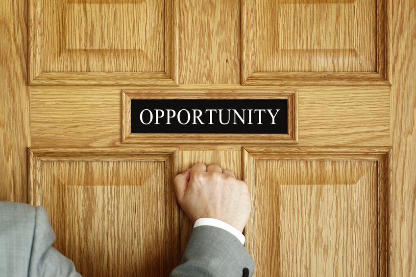 "Businessman knocking on a door to ""Opportunity"" office concept for aspirations, progress meeting or promotion"