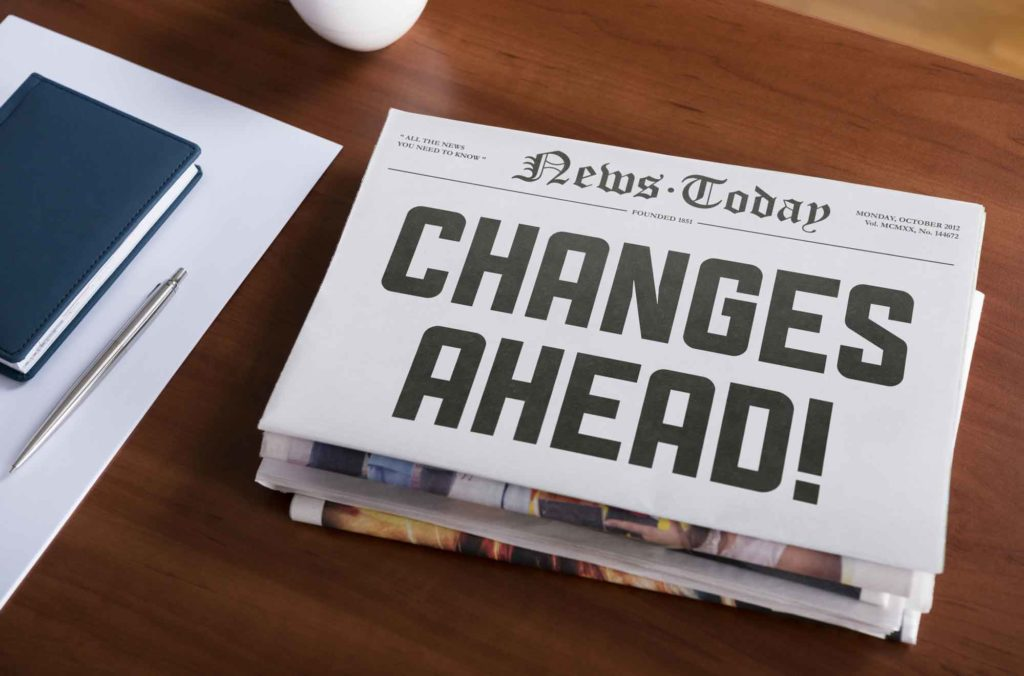 "Newspaper with ""Changes Ahead!"" headline"